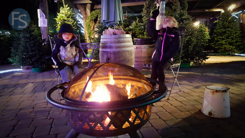Christmas Lights - Cambria Pines Lodge - Eddie and Montana getting warm at a fire pit  2015